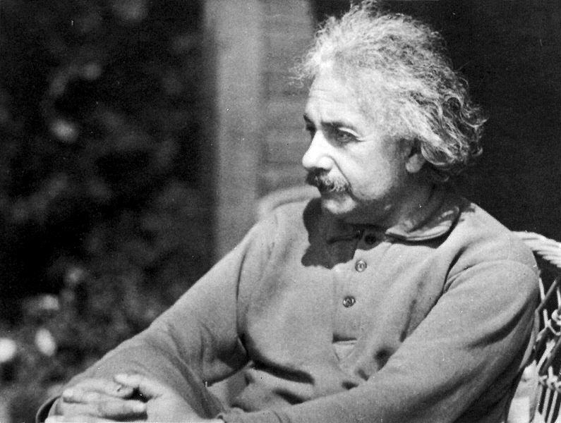 A photo of Albert Einstein sitting in a chair