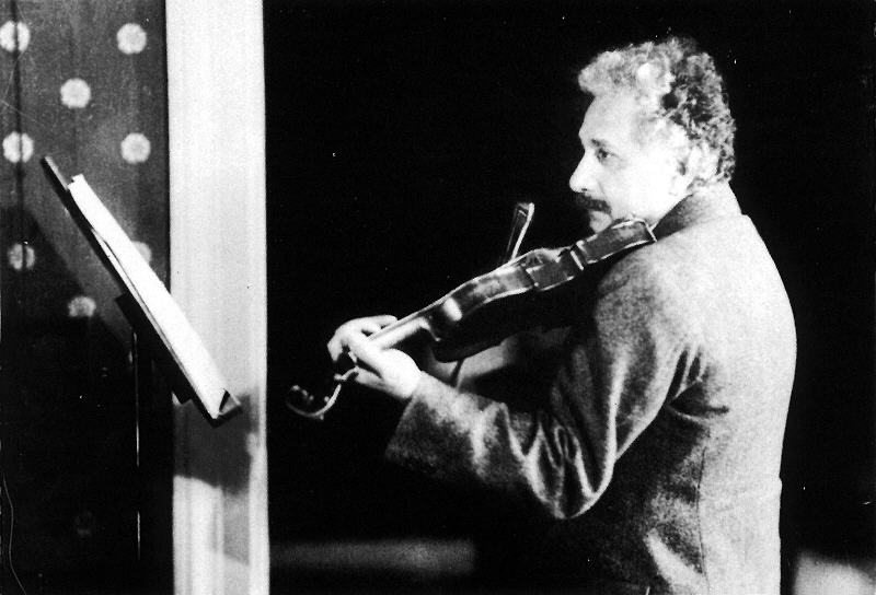 a photo of Albert Einstein playing the violin