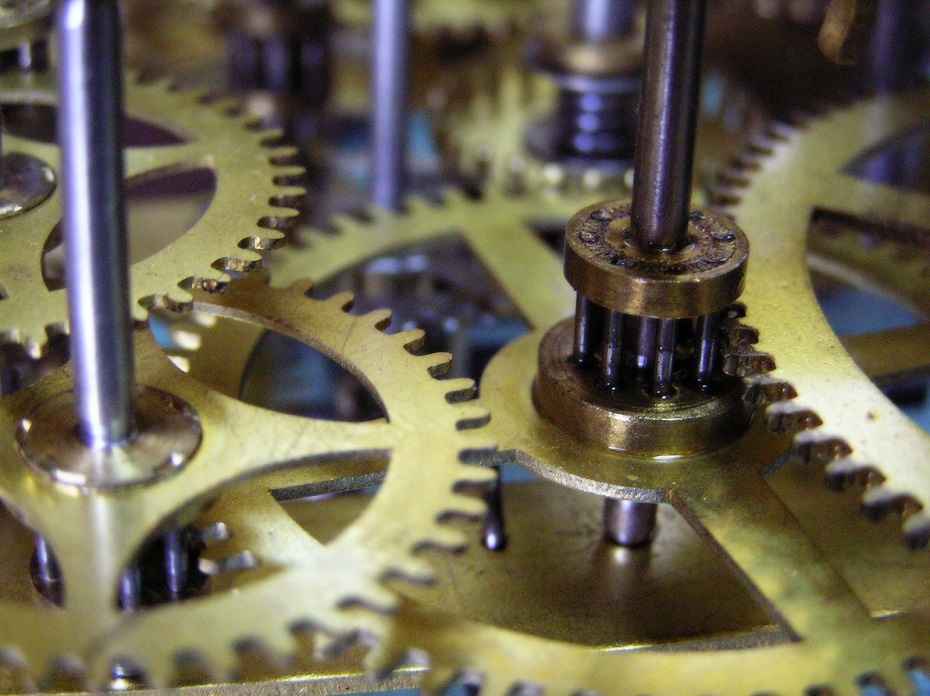 the bronze gears of a clock