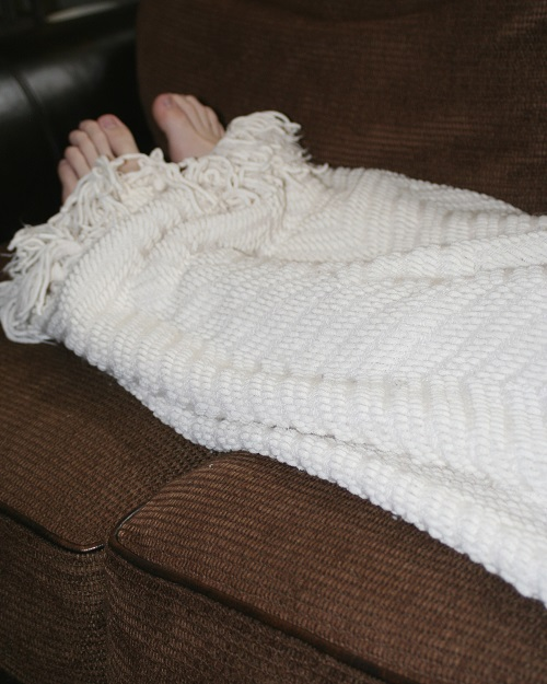 a persons legs under a blanket