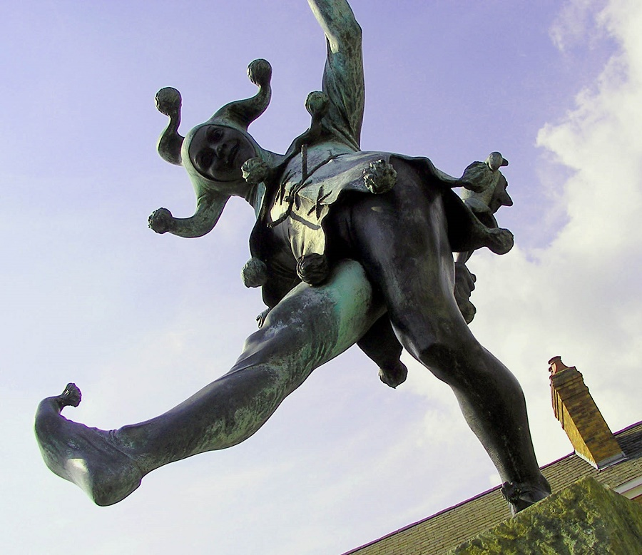 a statue of a dancing court jester
