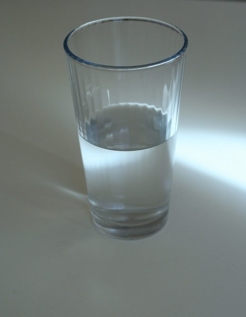 a glass of water which could appear to be half empty or half full depending on your perspective