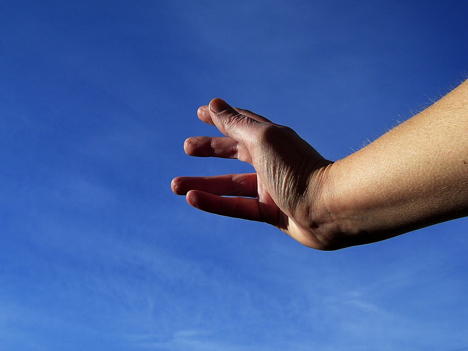 a hand reaching for the sky