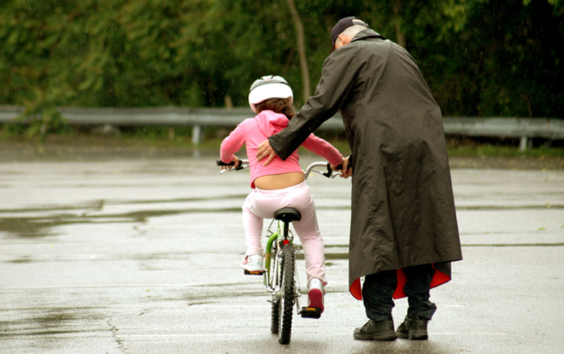 a child learning to ride a bicycle