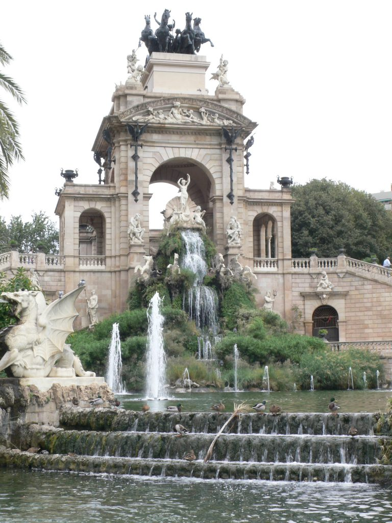 A grand and certainly substantial monument with fountains and lush grounds