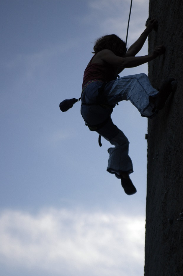 a climber ascends a wall
