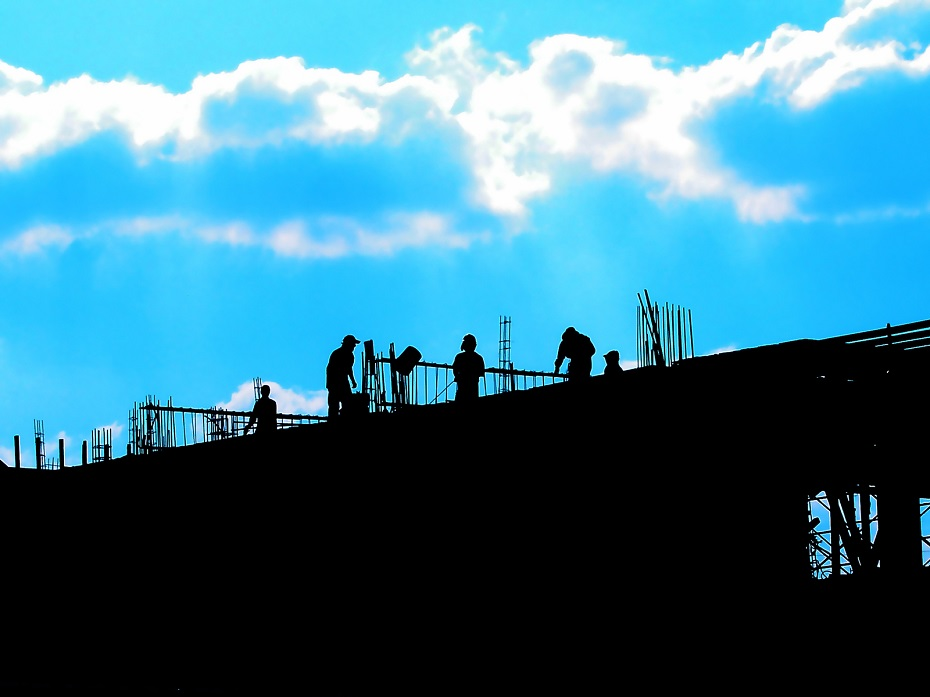 people working on the construction of a skyscraper