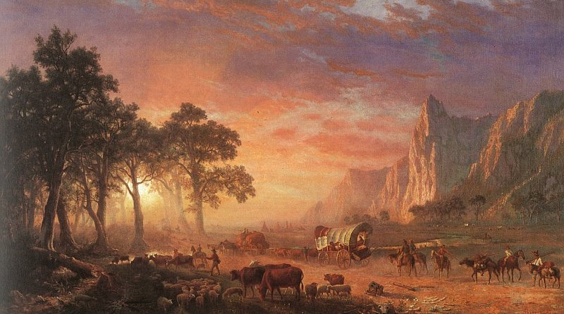 Pioneers head off into the sunset on the Oregon Trail