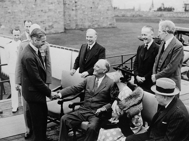 President Franklin D. Roosevelt meeting with the Prime Minister of Canada and Winston Churchill during World War II