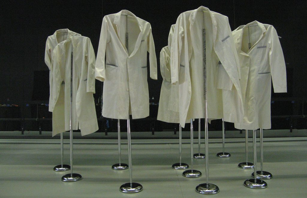 Lab coats on poles