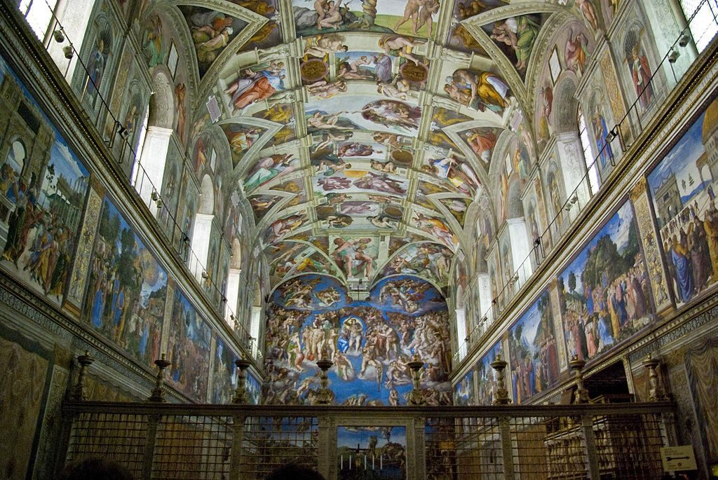 a photo of the paintings which adorn the walls and ceiling in the sistine chapel
