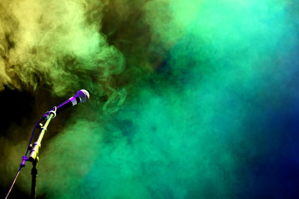 A microphone and some lit up smoke