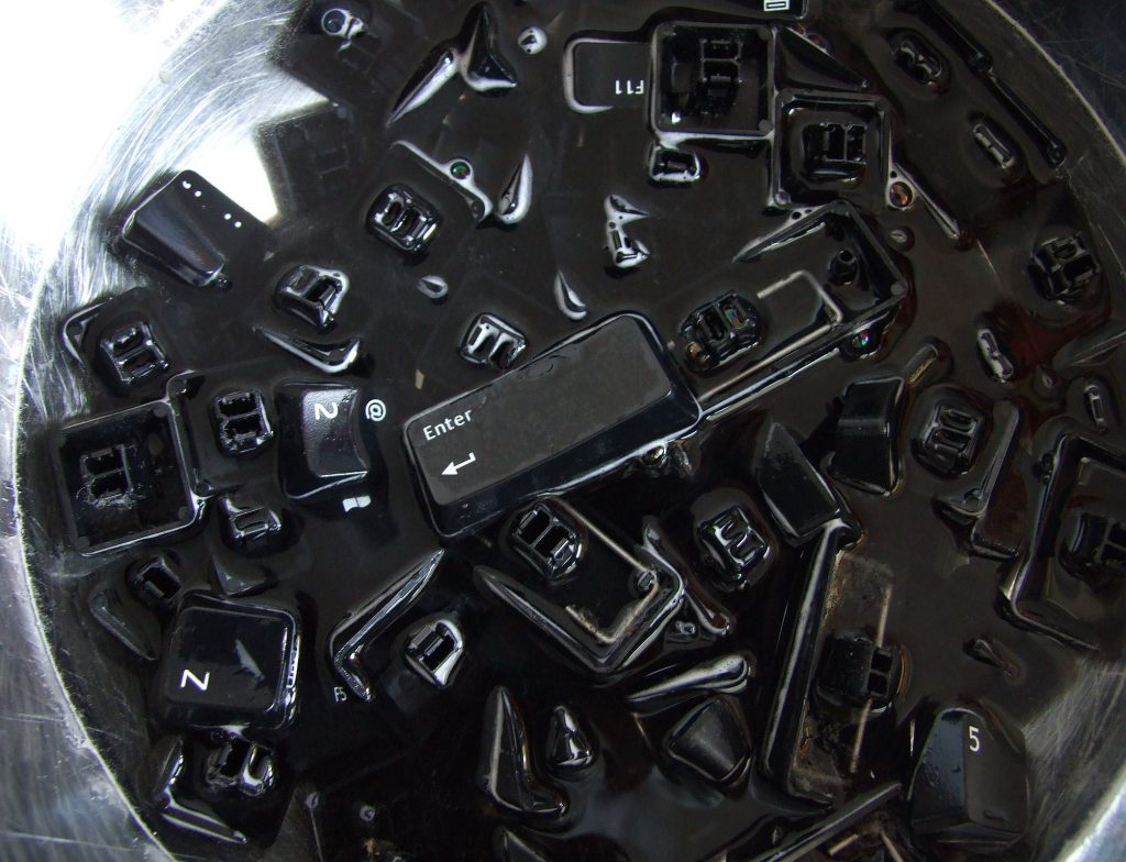 a bunch of keyboard keys in water