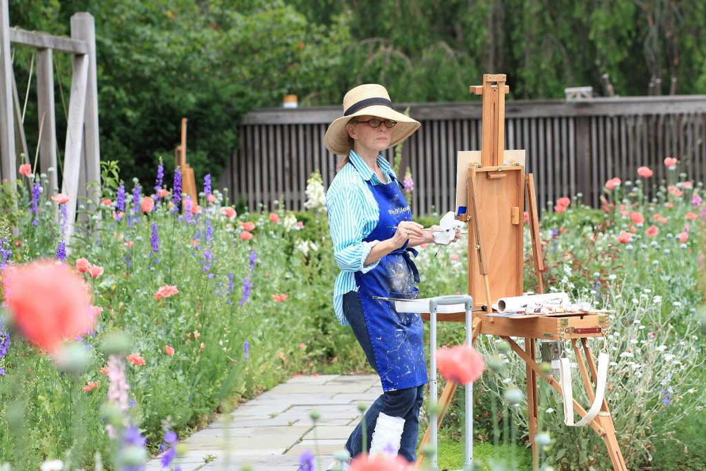 Woman painting at an Arboreum