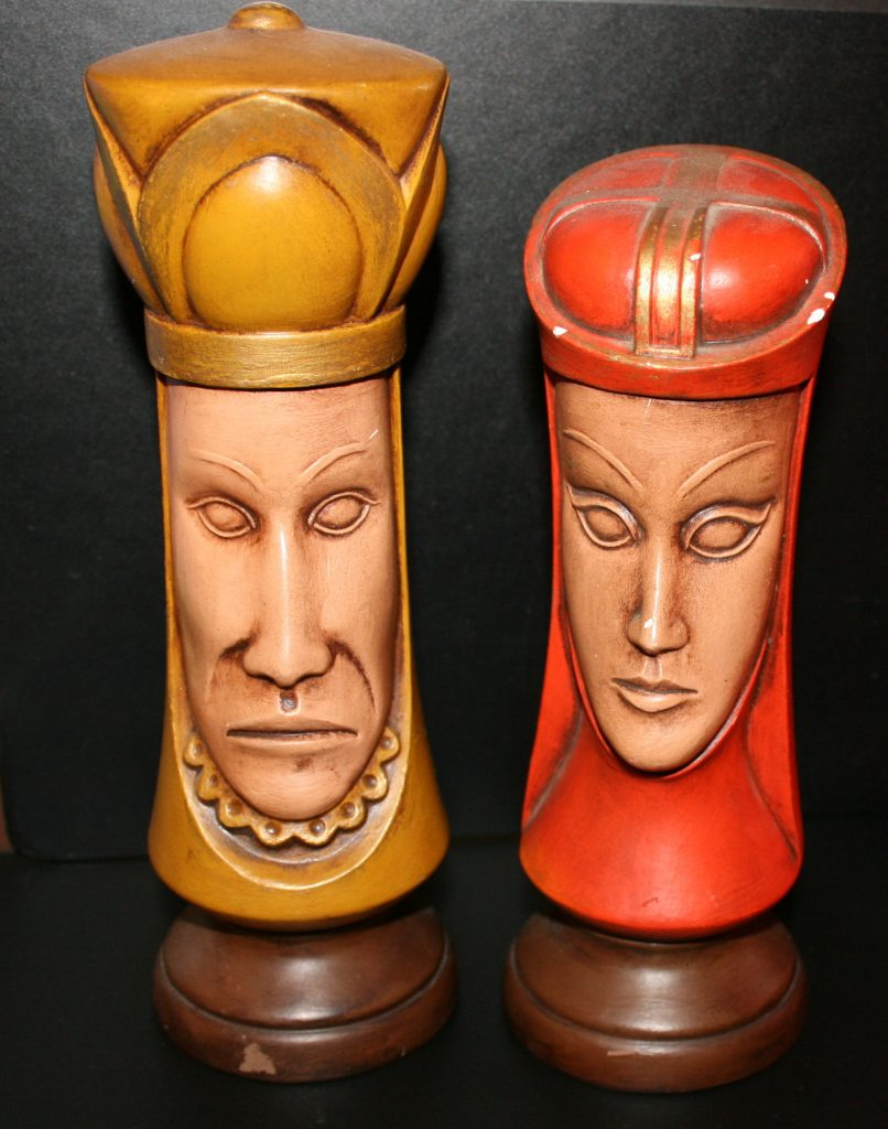 the king and queen pieces from a chess set