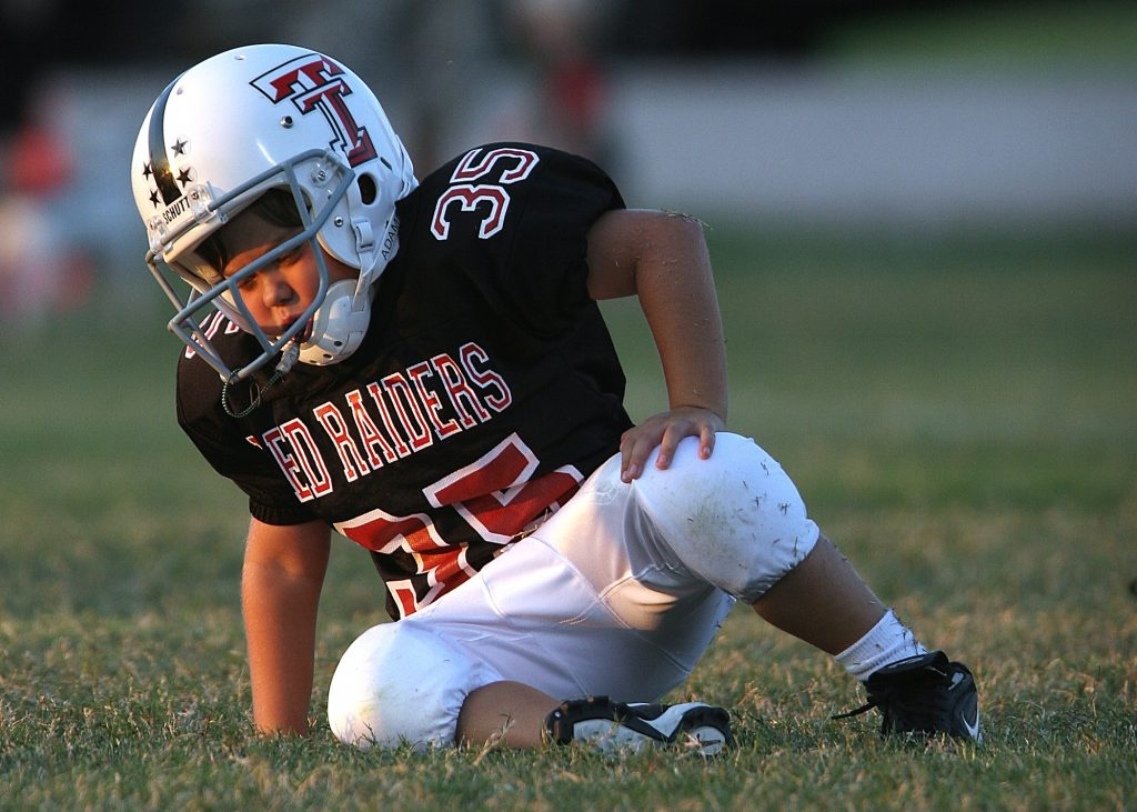 a child falls over during a youth league football practice
