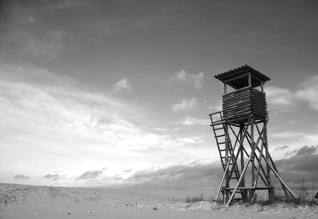 an old watchtower in the middle of a plain