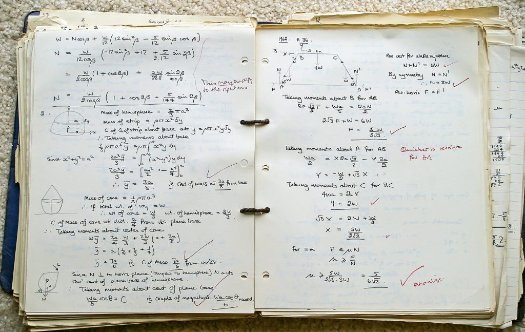 pages of corrected homeowork in a binder
