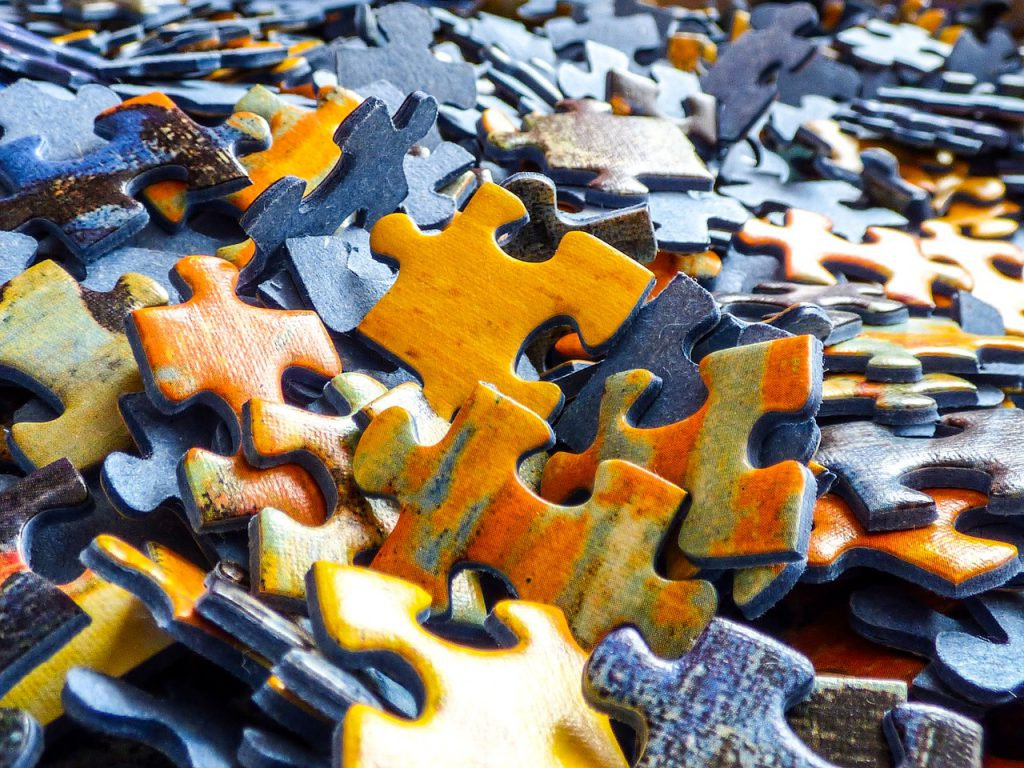 a multicolored pile of puzzle pieces