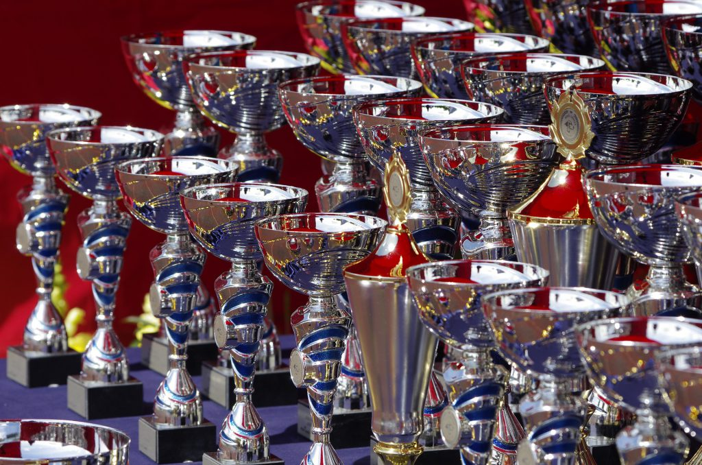 multiple rows of shiny trophies