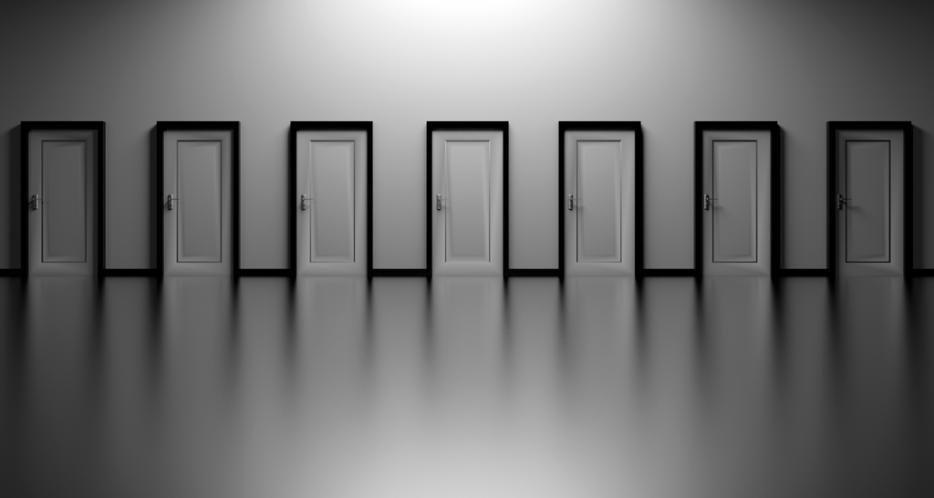 a row of multiple identical doors in a wall