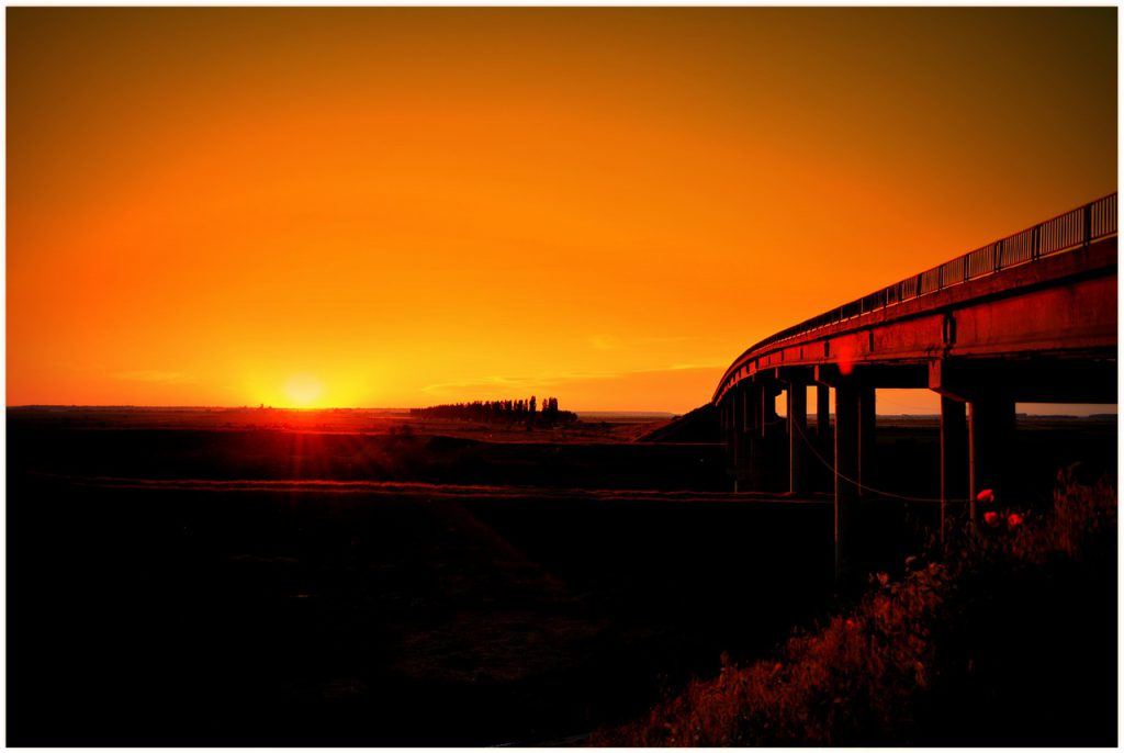 a bridge leading off into sunset