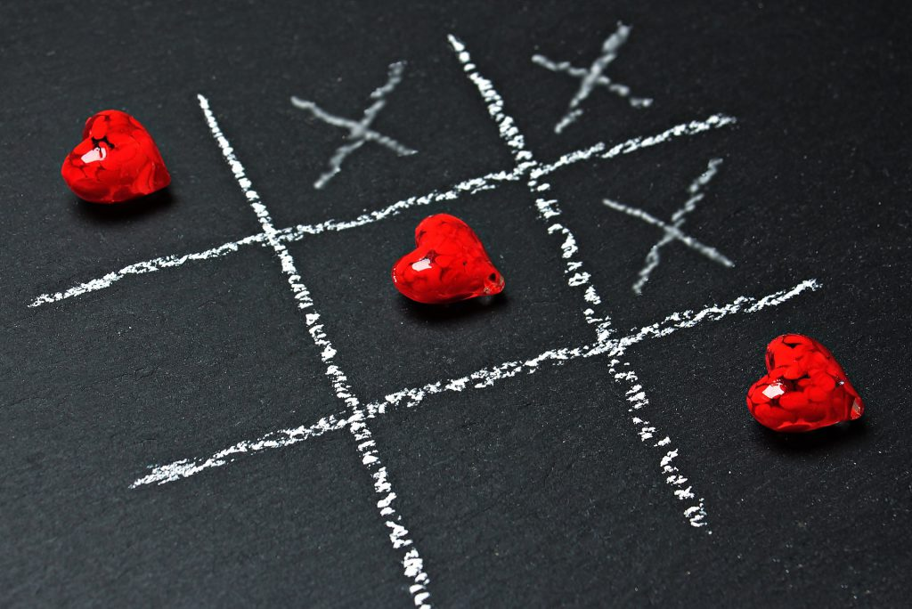 heart beads on a tic tac toe board