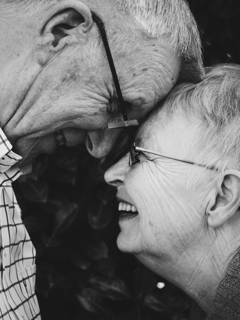 an old couple laughing with eachother