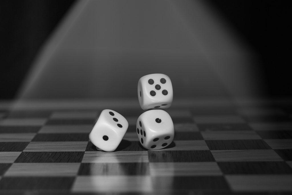 dice rolling across a chessboard