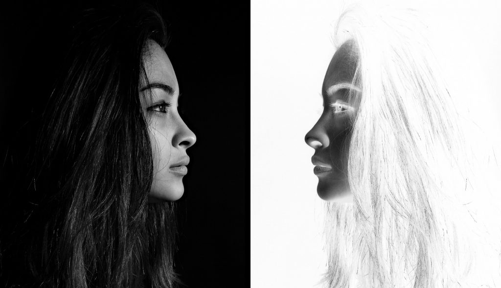 Woman looking at a negative reflection of herself with confidence
